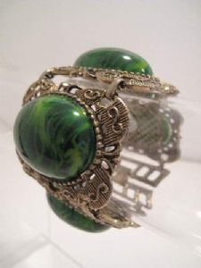 *On Hold * 1960's Large faux jade ornate vintage cuff.